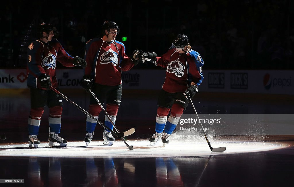Matt Duchene #9, Jamie McGinn #11 and Chuck Kobasew #12 of the Colorado Avalanche take the ice during player introductions against the Los Angeles Kings at the Pepsi Center on January 22, 2013 in Denver, Colorado. The Avalanche defeated the Kings 3-1.