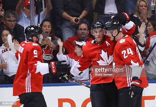 Matt Duchene Jonathan Toews and Corey Perry of Team Canada celebrate Toews goal during the first period against Team Europe at the World Cup of...