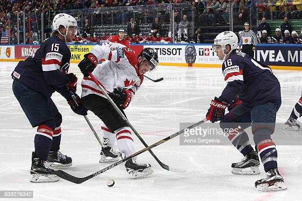 Matt Duchene of Canada and Noah Hanifin of USA battle for the puck at Ice Palace on May 21 2016 in Moscow Russia Canada defeated USA 43