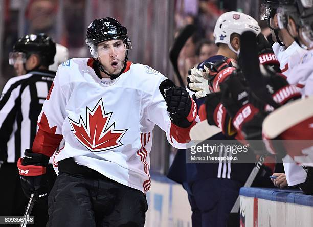 Matt Duchene of Team Canada high fives the bench after scoring a first period goal on Team USA during the World Cup of Hockey 2016 at Air Canada...
