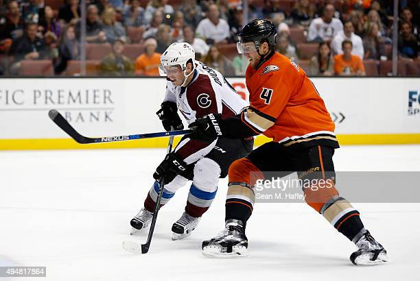 Matt Duchene of the Colorado Avalanche and Cam Fowler of the Anaheim Ducks battle for position during the second period of a game at Honda Center on...