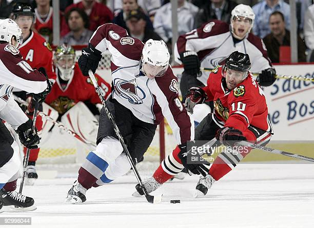 Matt Duchene of the Colorado Avalanche and Patrick Sharp of the Chicago Blackhawks chase after the puck on November 11 2009 at the United Center in...