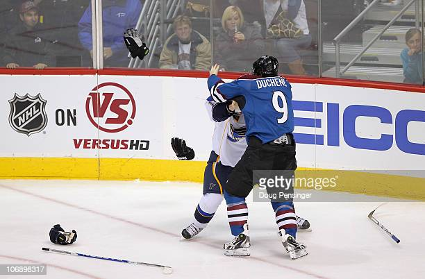 Matt Duchene of the Colorado Avalanche and Vladimir Sobotka of the St Louis Blues discard gloves and sticks as they commence fighting in the third...
