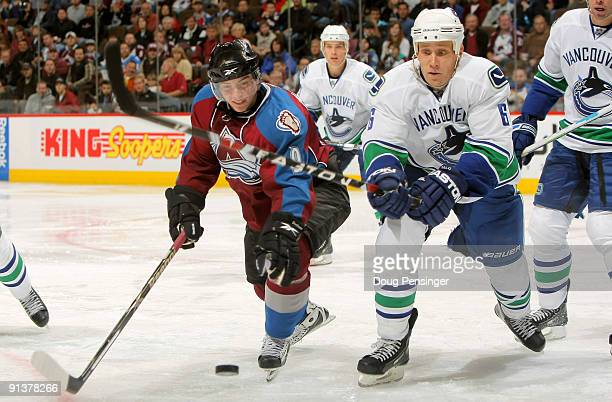 Matt Duchene of the Colorado Avalanche battles for control of the puck with Sami Salo of the Vancouver Canucks during NHL action at the Pepsi Center...