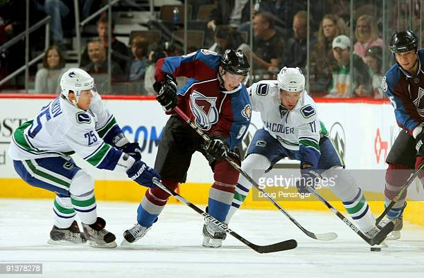 Matt Duchene of the Colorado Avalanche battles for control of the puck with Sergei Shirokov and Ryan Kesler of the Vancouver Canucks during NHL...