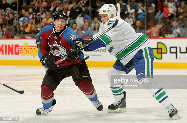 Matt Duchene of the Colorado Avalanche battles for position with Sami Salo of the Vancouver Canucks during NHL action at the Pepsi Center on October...