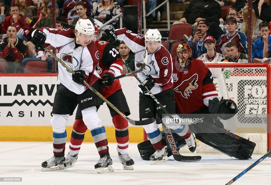 Matt Duchene #9 of the Colorado Avalanche blocks the view of goalie Mike Smith #41 of the Arizona Coyotes as Mikko Rantanen #96 of the Avalanche attempts to re-direct the puck while Oliver Ekman-Larsson #23 of the Coyotes defends during the third period at Gila River Arena on March 13, 2017 in Glendale, Arizona.