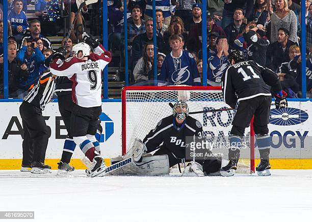 Matt Duchene of the Colorado Avalanche celebrates a goal as goalie Ben Bishop and Brian Boyle react during the third period at the Amalie Arena on...