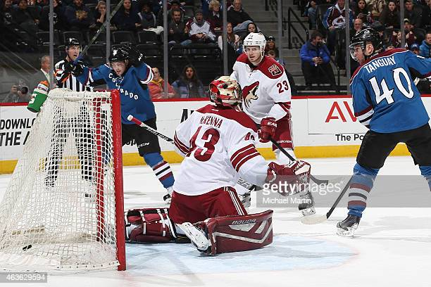 Matt Duchene of the Colorado Avalanche celebrates a goal as teammate Alex Tanguay looks on against goaltender Mike McKenna and Oliver EkmanLarsson of...