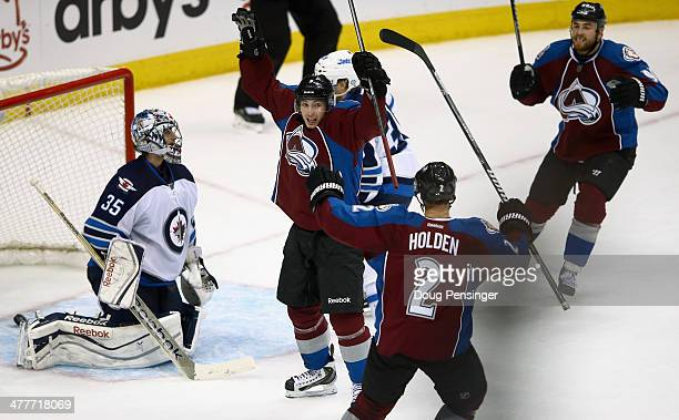 Matt Duchene of the Colorado Avalanche celebrates after scoring the game winning goal in overtime against goalie Al Montoya of the Winnipeg Jets as...