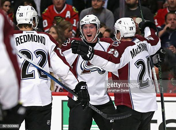 Matt Duchene of the Colorado Avalanche celebrates his first period goal with teammates Zach Redmond and Nathan MacKinnon against the Chicago...