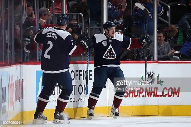 Matt Duchene of the Colorado Avalanche celebrates his goal against the Pittsburgh Penguins with Nick Holden of the Colorado Avalanche to take a 10...