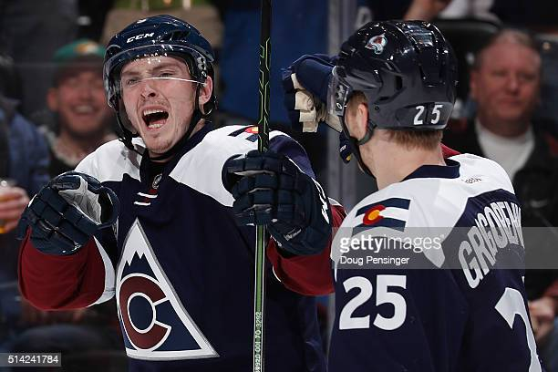 Matt Duchene of the Colorado Avalanche celebrates his goal against the Arizona Coyotes with Mikhail Grigorenko of the Colorado Avalanche to take a 20...