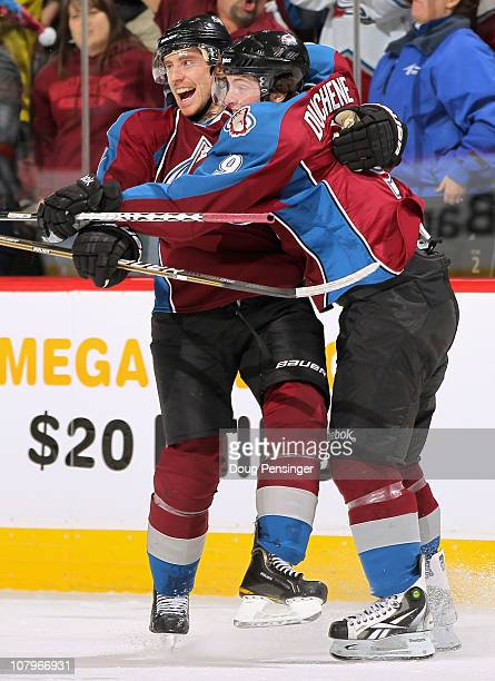 Matt Duchene of the Colorado Avalanche celebrates his second goal in the first period with teammate Tomas Fleischmann against the Detroit Red Wings...