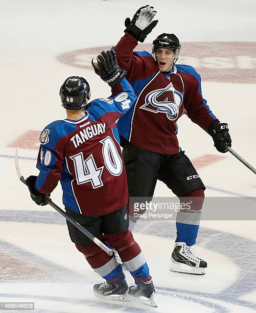 Matt Duchene of the Colorado Avalanche celebrates with Alex Tanguay of the Colorado Avalanche after Tanguay scored the game winning goal against...
