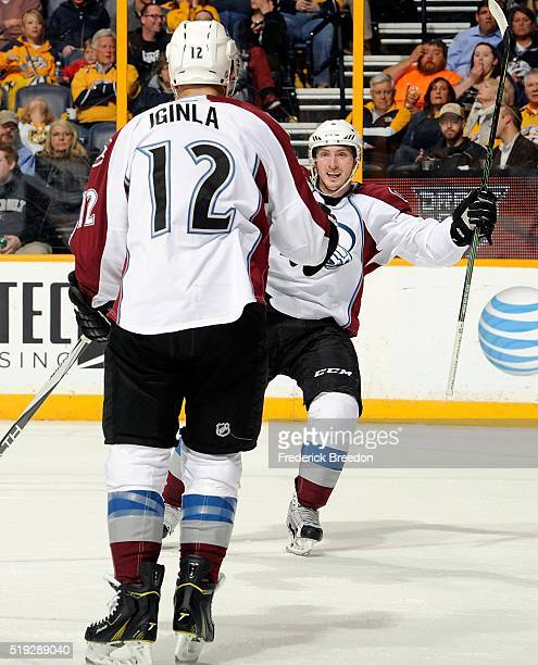 Matt Duchene of the Colorado Avalanche celebrates with teammate Jarome Iginla after a goal against the Nashville Predators during the second period...