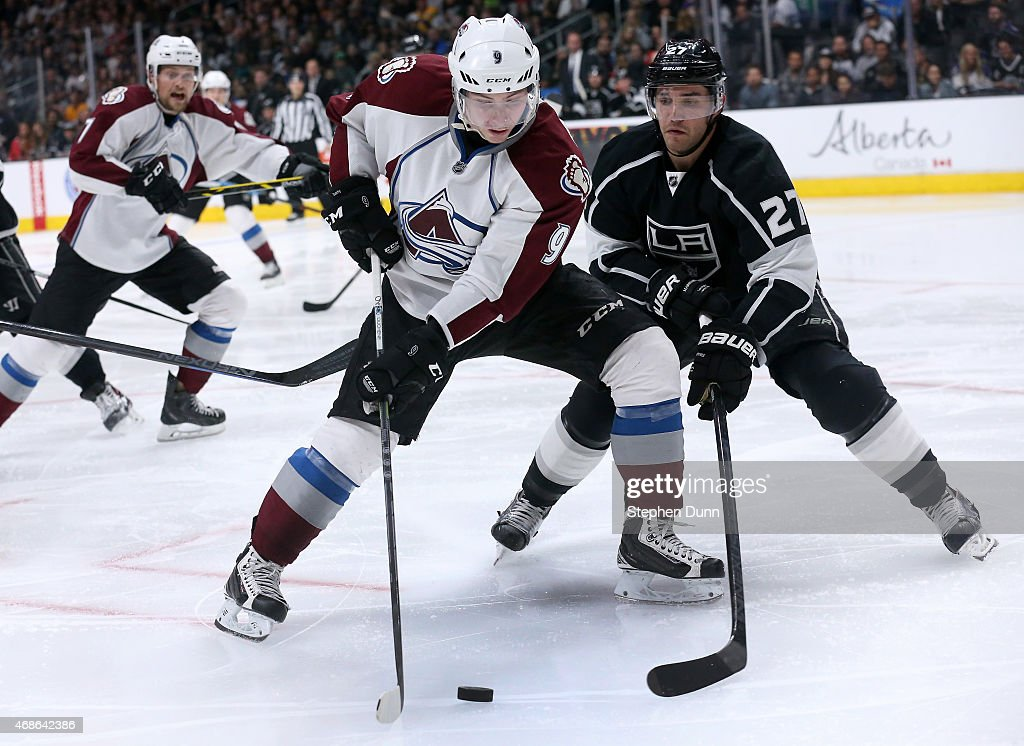 Matt Duchene #9 of the Colorado Avalanche controls the puck in front of Alec Martinez #27 of the Los Angeles Kings at Staples Center on April 4, 2015 in Los Angeles, California. The Kings won 3-1.