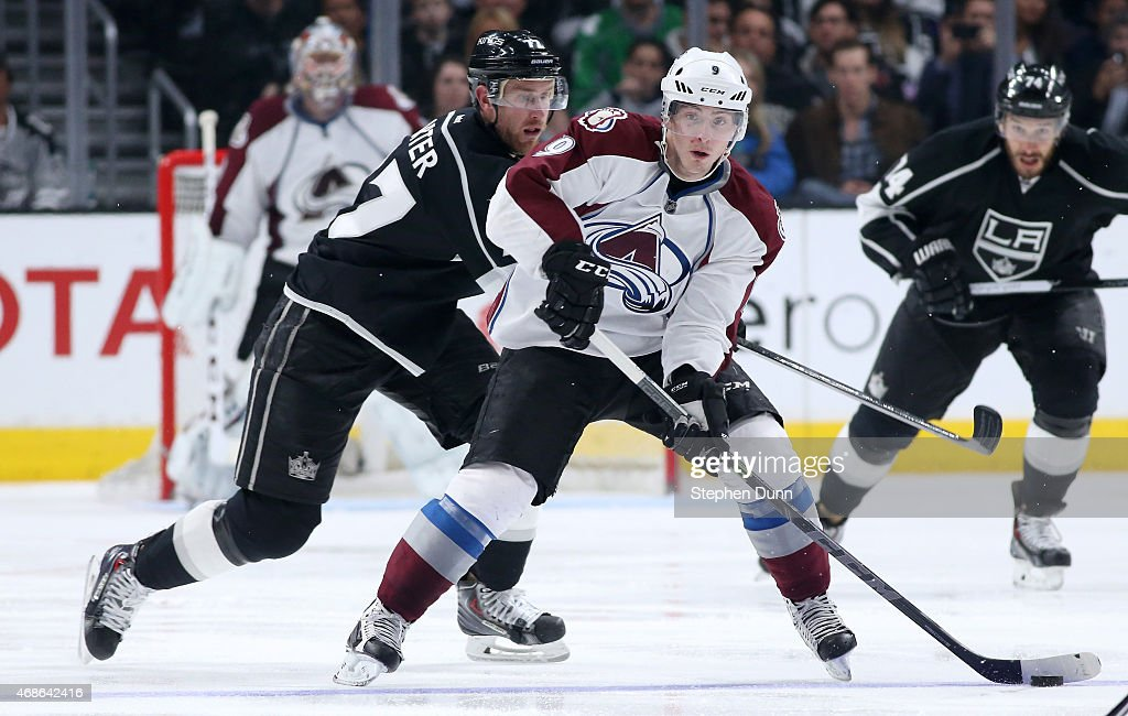 Matt Duchene #9 of the Colorado Avalanche controls the puck in front of Jeff Carter #77 of the Los Angeles Kings at Staples Center on April 4, 2015 in Los Angeles, California. The Kings won 3-1.