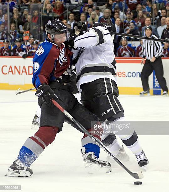 Matt Duchene of the Colorado Avalanche controls the puck on a short handed breakaway and Alec Martinez of the Los Angeles Kings is penalized for...