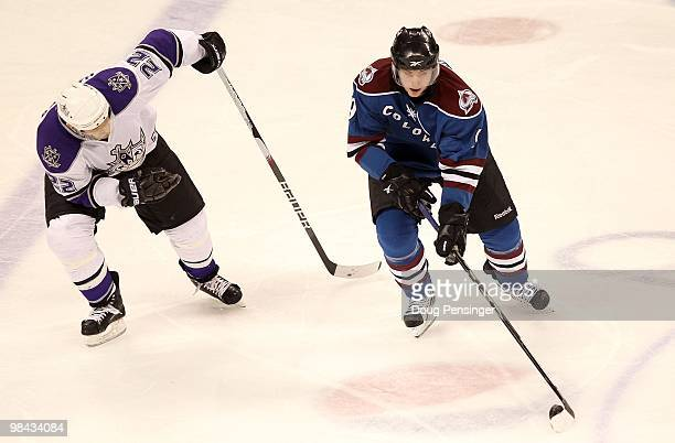 Matt Duchene of the Colorado Avalanche controls the puck while Jeff Halpern of the Los Angeles Kings defends during NHL action at the Pepsi Center on...