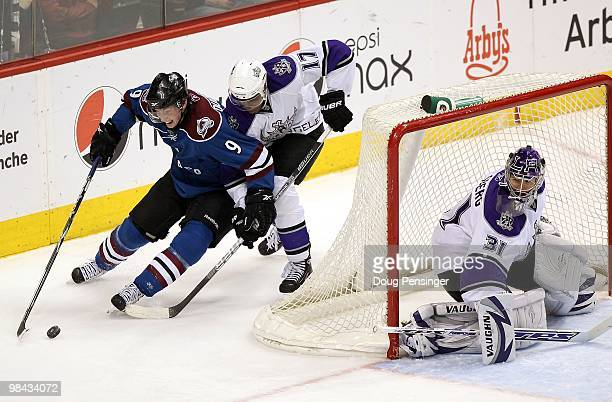 Matt Duchene of the Colorado Avalanche controls the puck while under pressure from Wayne Simmons as goalie Erik Ersberg of the Los Angeles Kings...