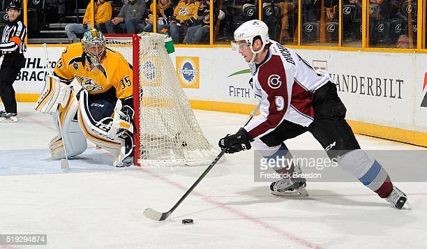 Matt Duchene of the Colorado Avalanche corrals the puck in front of goalie Pekka Rinne of the Nashville Predators during the second period at...