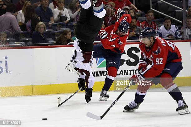 Matt Duchene of the Colorado Avalanche flips over Dmitry Orlov of the Washington Capitals in the first period at Verizon Center on October 18 2016 in...