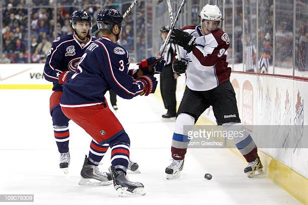 Matt Duchene of the Colorado Avalanche flips the puck past Marc Methot of the Columbus Blue Jackets on February 11 2011 at Nationwide Arena in...