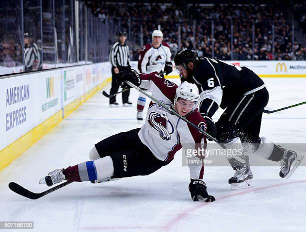 Matt Duchene of the Colorado Avalanche is tripped by Jake Muzzin of the Los Angeles Kings for a penalty during the third period at Staples Center on...