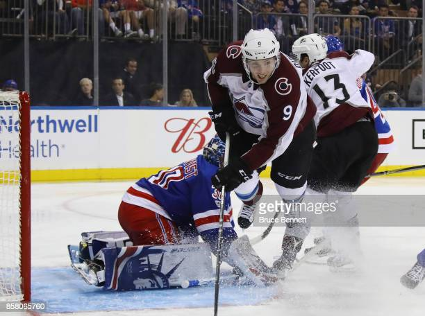 Matt Duchene of the Colorado Avalanche is tripped up as he misses a third period attempt against Henrik Lundqvist of the New York Rangers at Madison...