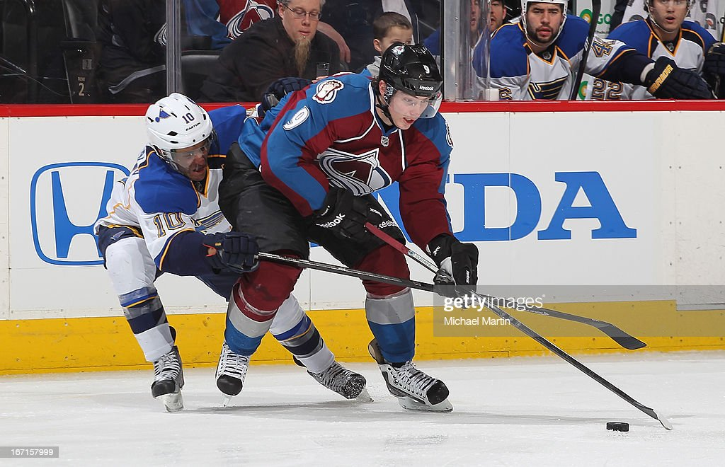 Matt Duchene #9 of the Colorado Avalanche keeps the puck away from Andy McDonald #10 of the St Louis Blues at the Pepsi Center on April 21, 2013 in Denver, Colorado. The Avalanche defeated the Blues 5-3.