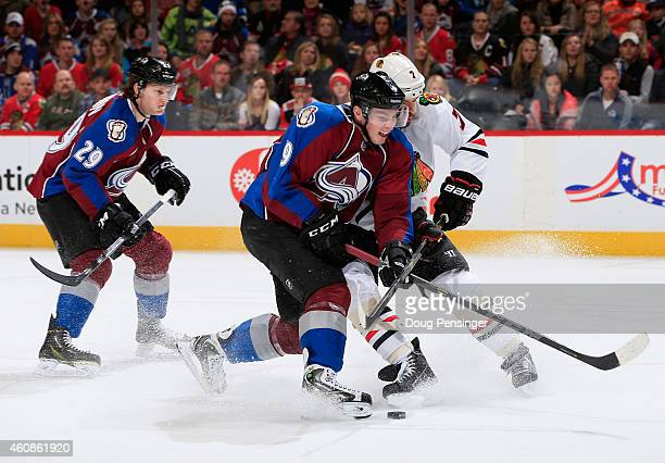 Matt Duchene of the Colorado Avalanche looses control of the puck against Brent Seabrook of the Chicago Blackhawks at Pepsi Center on December 27...