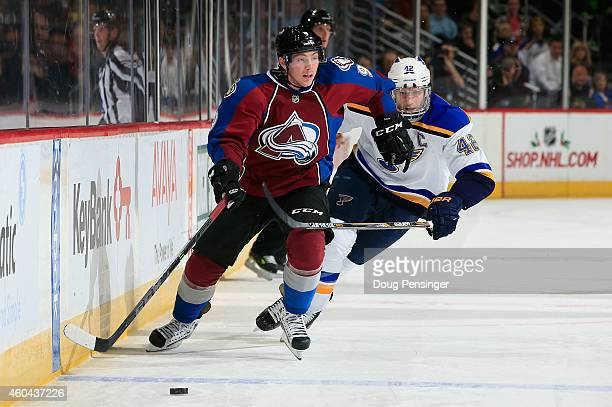 Matt Duchene of the Colorado Avalanche moves the puck across the blue line against David Backes of the St Louis Blues at Pepsi Center on December 13...