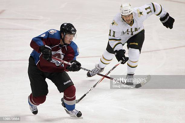Matt Duchene of the Colorado Avalanche passes the puck as Jake Dowell of the Dallas Stars defends during their preseason game at the Pepsi Center on...