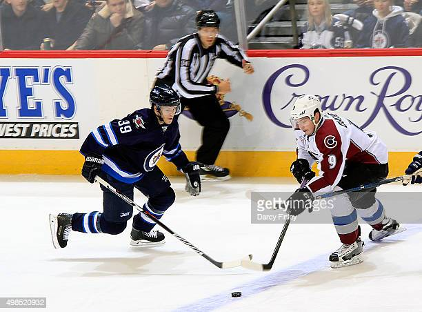 Matt Duchene of the Colorado Avalanche plays the puck up the ice as Toby Enstrom of the Winnipeg Jets defends during third period action at the MTS...