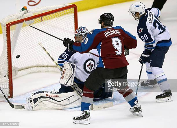Matt Duchene of the Colorado Avalanche puts the puck past goalie Al Montoya of the Winnipeg Jets for the game winning goal in overtime at Pepsi...