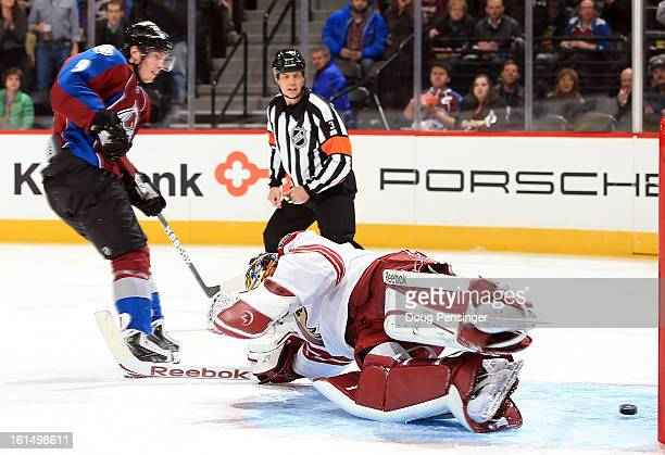 Matt Duchene of the Colorado Avalanche puts the puck past goalie Mike Smith of the Phoenix Coyotes to give the Avalanche a 20 lead over the Coyotes...