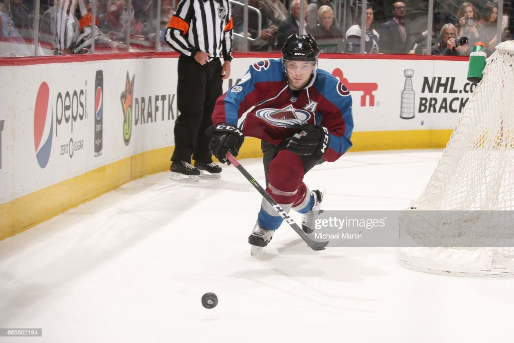 Matt Duchene #9 of the Colorado Avalanche reaches for the puck during the game against the Minnesota Wild at the Pepsi Center on April 6, 2017 in Denver, Colorado. The Wild defeated the Avalanche 4-3.
