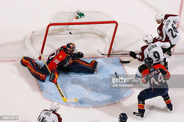 Matt Duchene of the Colorado Avalanche scores a goal past Goaltender Scott Clemmensen of the Florida Panthers in the second period on December 2 2009...
