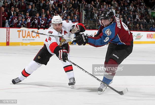 Matt Duchene of the Colorado Avalanche scores the winning overtime goal against Chris Phillips of the Ottawa Senators at the Pepsi Center on December...