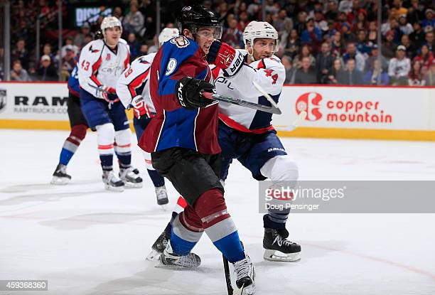 Matt Duchene of the Colorado Avalanche skates against Brooks Orpik of the Washington Capitals at Pepsi Center on November 20 2014 in Denver Colorado...