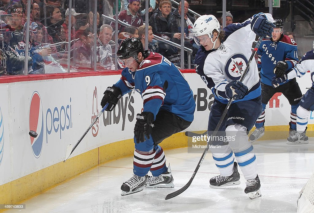 Matt Duchene #9 of the Colorado Avalanche skates against Jacob Trouba #8 of the Winnipeg Jets at the Pepsi Center on December 29, 2013 in Denver, Colorado. The Jets defeated the Avalanche 2-1 in overtime.Ê