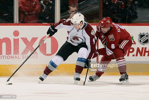 Matt Duchene of the Colorado Avalanche skates with the puck as David Schlemko of the Arizona Coyotes defends during the third period at Gila River...