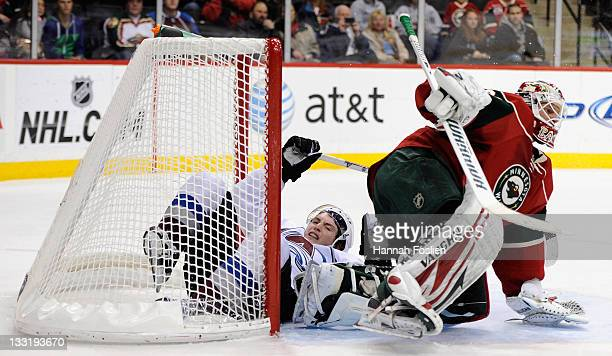 Matt Duchene of the Colorado Avalanche slides past Niklas Backstrom of the Minnesota Wild and into the net in the first period on November 17 2011 at...