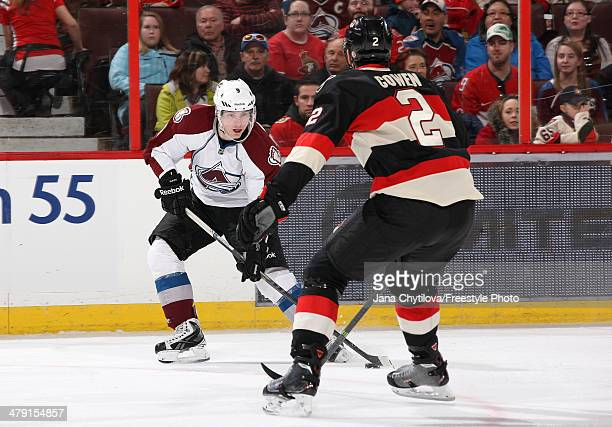 Matt Duchene of the Colorado Avalanche stickhandles the puck against Jared Cowen of the Ottawa Senators during an NHL game at Canadian Tire Centre on...