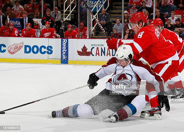 Matt Duchene of the Colorado Avalanche tries to control the puck while being checked by Justin Abdelkader of the Detroit Red Wings during the first...
