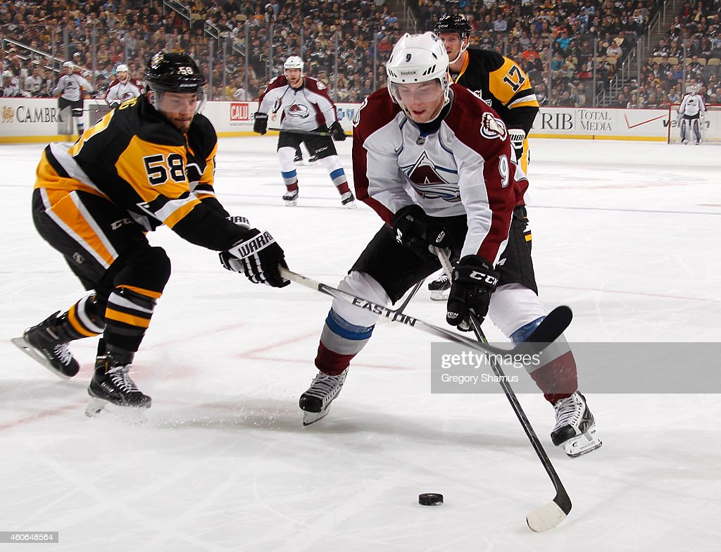 Matt Duchene #9 of the Colorado Avalanche tries to skates past the defense of Kris Letang #58 of the Pittsburgh Penguins at Consol Energy Center on December 18, 2014 in Pittsburgh, Pennsylvania.