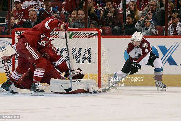 Matt Duchene of the Colorado Avalanche tries to slip the puck past the pad of goaltender Mike Smith of the Arizona Coyotes during the third period at...