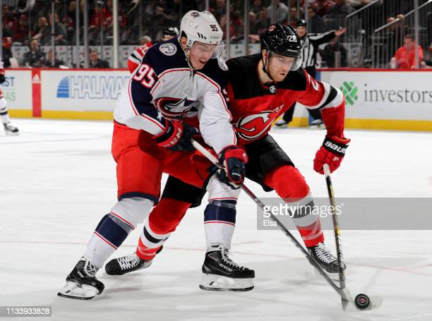 Matt Duchene of the Columbus Blue Jackets and Damon Severson of the New Jersey Devils fight for the puck on March 05 2019 at Prudential Center in...