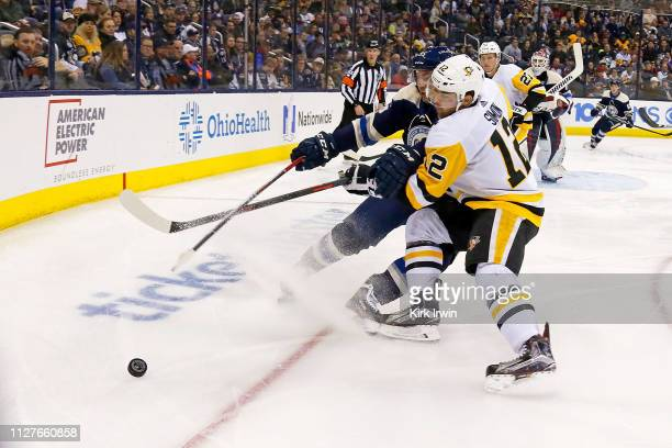 Matt Duchene of the Columbus Blue Jackets and Dominik Simon of the Pittsburgh Penguins battle for control of the puck during the third period on...